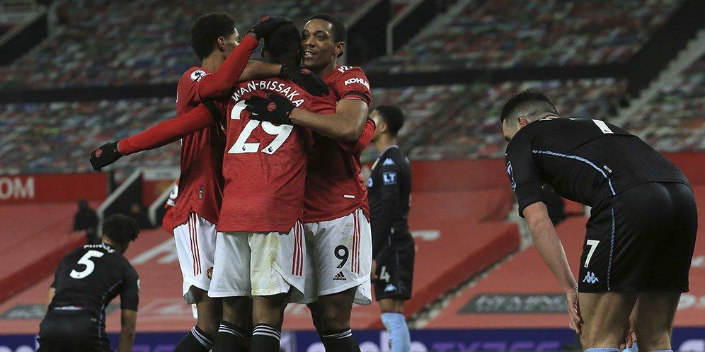 Manchester United merayakan gol yang dicetak Anthony Martial saat menghadapi Aston Villa dalam laga lanjutan Premier League, Sabtu (2/1/2021).